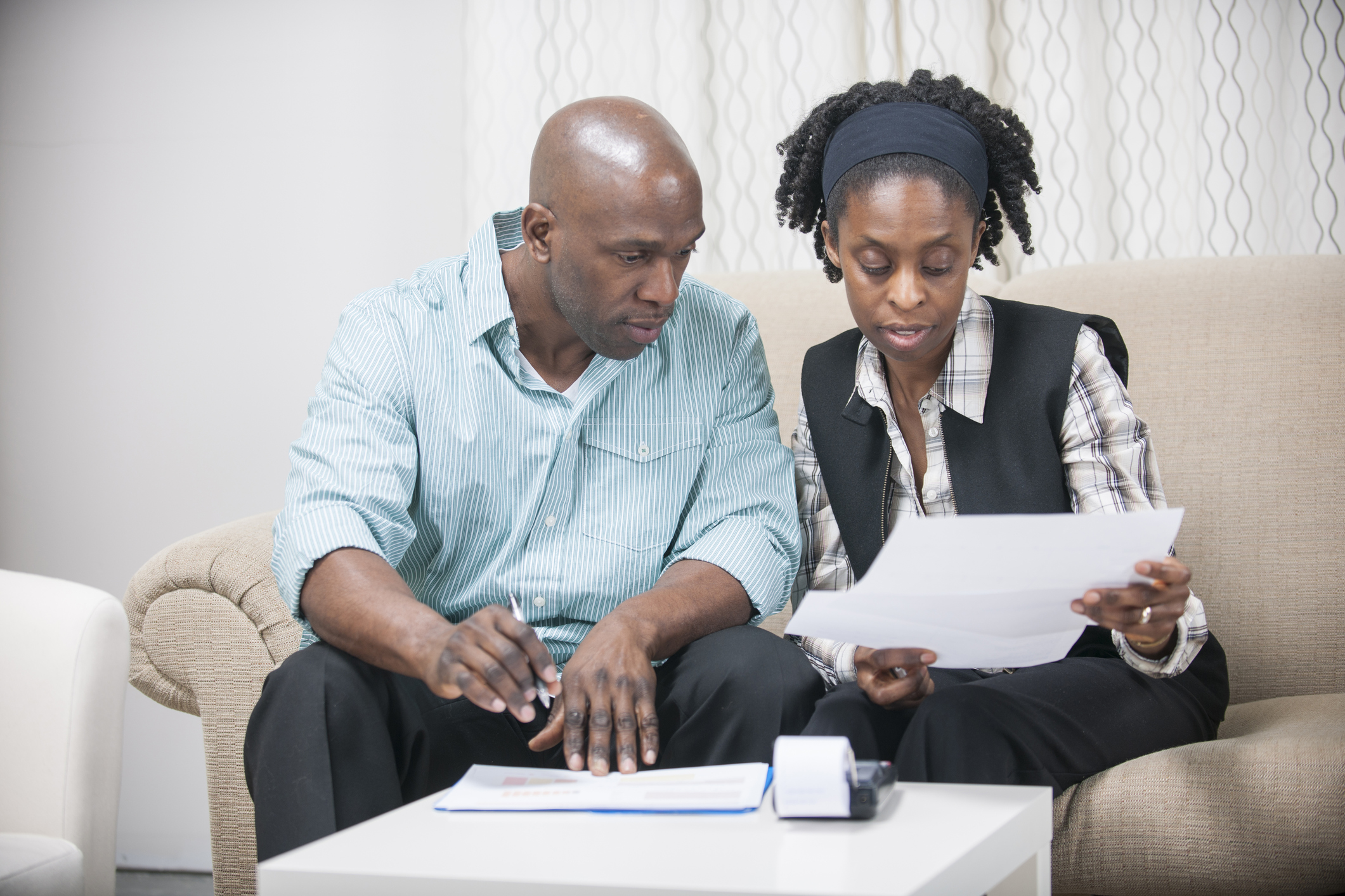 couple sits together reviewing their finances