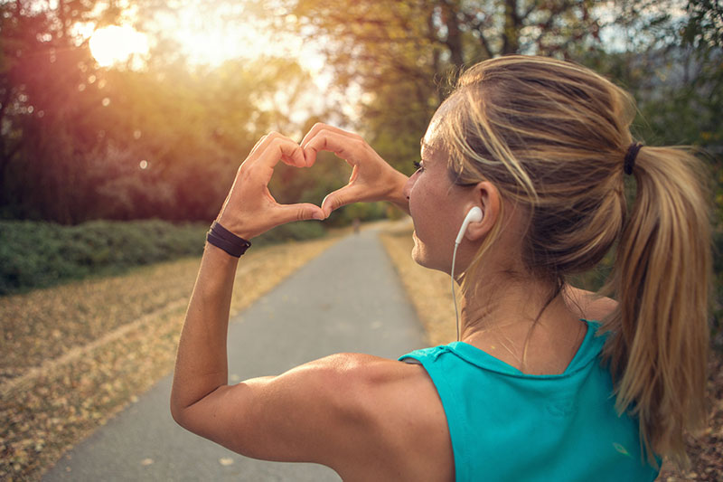 woman-running-making-heart-with-hand