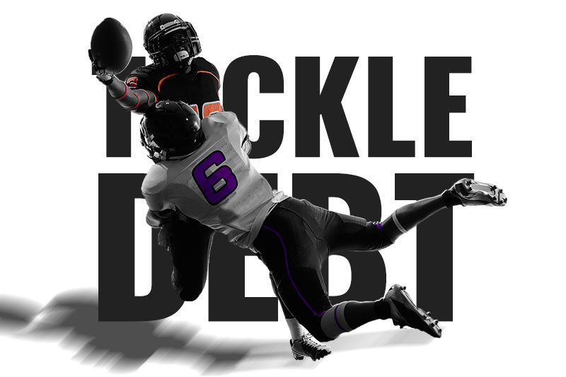 football players tackle eachother tackle debt