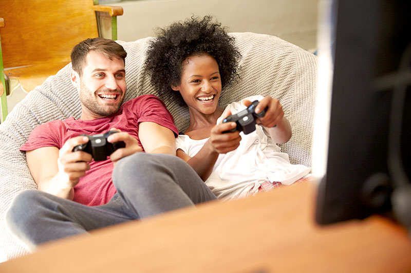 young woman and man play video games