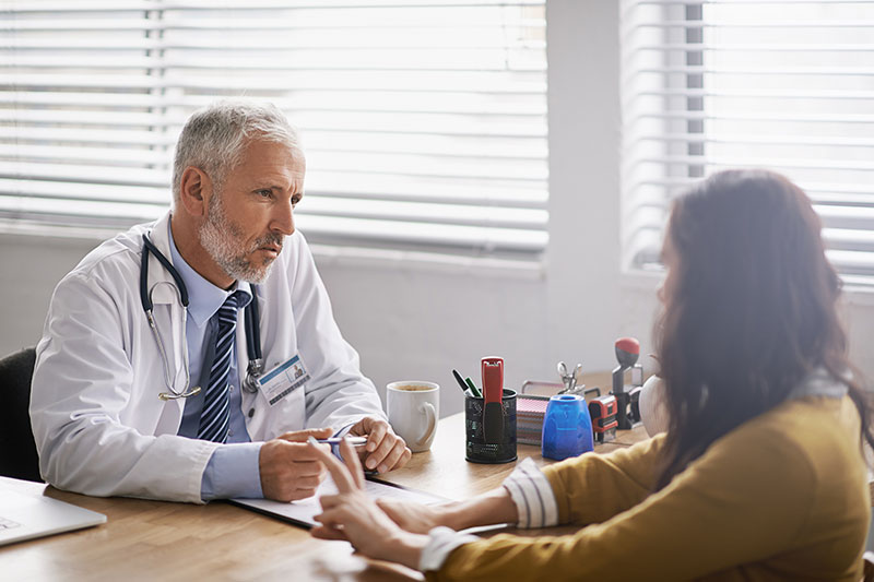 woman talks to her doctor about women's health