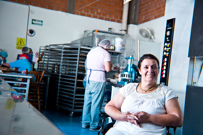 lady in a wheelchair in a commercial bakery